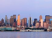 New York City Manhattan sunset panorama with historical skyscrapers over Hudson River viewed from Ne