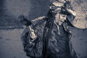 foto of shaman  - Portrait of a shaman dancing with a drum outdoor - JPG