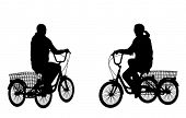 stock photo of tricycle  - young woman riding tricycle silhouettes - JPG
