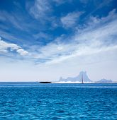 Es Vedra Ibiza silhouette with boats view from Formentera in Balearic islands