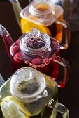 Three Square Teapots With Different Fruit Tastes Of Tea