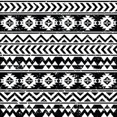 Aztec tribal seamless grunge white pattern on black background