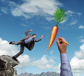 image of dangling a carrot  - Businessman trying to reach a dangling carrot being drawn in the sky by a giant hand concept for business motivation - JPG