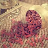 Vintage retra style red dried goji berries, wolfberry or lycium, chinese herbal medicine close-up on