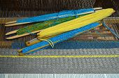 stock photo of loom  - Weaving on the loom with thread various colors - JPG