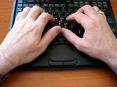 Man's hand on thinkpad keyboard