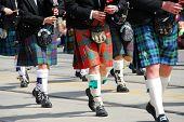 stock photo of bagpiper  - Scottish marching band at city parade - JPG