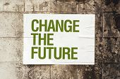 Change The Future Poster On Grunge Wall