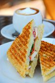 Grilled chicken sandwich and a cup of coffee