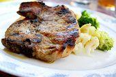 Pork chip dinner with steamed vegetables