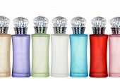 colored glass bottles of perfume isolated on white background.