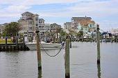 image of pontoon boat  - boats moored in Hatteras harbour - JPG