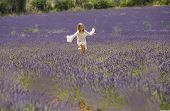 Young girl runs in field of lavender, Provence