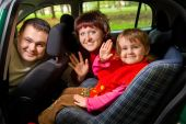 Married Couple And  Little Girl  Greeting To Wave Hands In Car