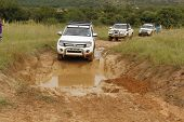 White Ford Ranger Xls With Silver Canopy Crossing Mud Obstacle