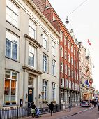 Amsterdam, Netherlands.-APRIL 23: Traditional old buildings on April 23, 2014. Beautiful street view