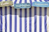 Specicalty Coffees Advertised On A Color Circus Style Tent