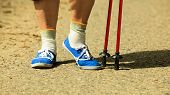 Active Woman Senior Nordic Walking In Park. Legs