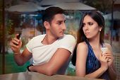 picture of possess  - Young adult couple has privacy problems with modern technology - JPG