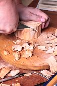 carpenter hand carving wood
