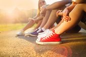 Sneakers of teenage boys and girls