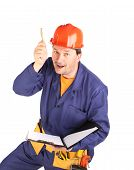Worker in hard hat with pen.