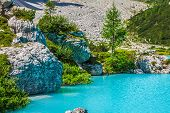 Turquoise Sorapis Lake With Pine Trees And Dolomite Mountains In The Back - Sorapis Circuit, Dolomit