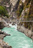 Hanging Suspension Bridge In Himalaya Mountains, Nepal.