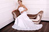 Beautiful Bride With Long Blond Hair In Elegant Dress