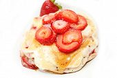 Pancakes Coved With Fresh Strawberries And Syrup
