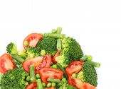 Broccoli salad with tomatoes and green peas.