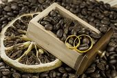 Wedding rings in a drawer filled with coffee beans