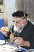 MUSKOGEE, OK - MAY 24: Skillful merchant shows off his crafts at the Oklahoma 19th annual Renaissanc