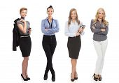 Full-length portrait of smiling businesswomen, cutout on white background.