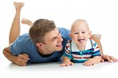 Happy Father And Baby Son Having Fun Pastime