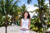 Beautiful Young Woman Under Tropical Palm Trees