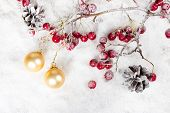 Christmas-tree Balls On A Branch With Red Berries And Pine Cones