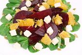 Beet salad with cheese and orange.