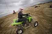 Female Having Fun Riding Atv At The Beach