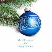 Blue Christmas Ball And Green Spruce Branch Isolated On White Background