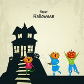 Trick or Treat night party concept with little kids in pumpkin mask enjoying outside haunted house o