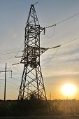 Electricity Pylons, power lines against Sunset
