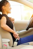 picture of seatbelt  - woman driver buckle up the seat belt before driving car  - JPG