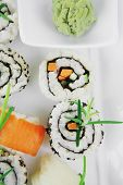 Maki Rolls and California rolls made of fresh raw Salmon, Tuna and Eel with Cream Cheese and Avocado