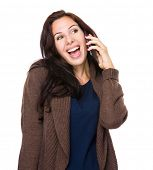 Happy woman talk to mobile phone