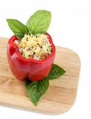 Pepper prepared for cooking stuffed paprika with meat and rice, on wooden cutting board, isolated on