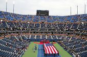 US Marine Corps unfurling American Flag  during the opening ceremony of the US Open 2014 men final