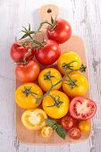 red and yellow tomato on board