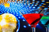 Red Cocktail With Golden Sparkling Disco Ball Background With Space For Text