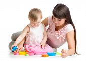 Mother And Daughter Play Together With Cup Toys